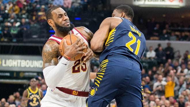 Jan 12, 2018; Indianapolis, IN, USA; Cleveland Cavaliers forward LeBron James (23) is fouled by Indiana Pacers forward Thaddeus Young (21) in the first half at Bankers Life Fieldhouse.