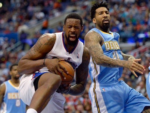 April 15, 2014: Clippers center DeAndre Jordan, left, grabs a rebound in a 117-1105 win against the Nuggets. The victory keeps their hopes of snatching the West's No. 2 seed from the Thunder alive.