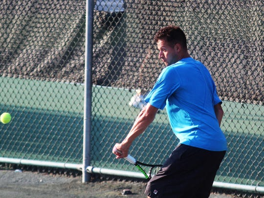 Wyatt Lippert hits a backhand during the men's semifinals