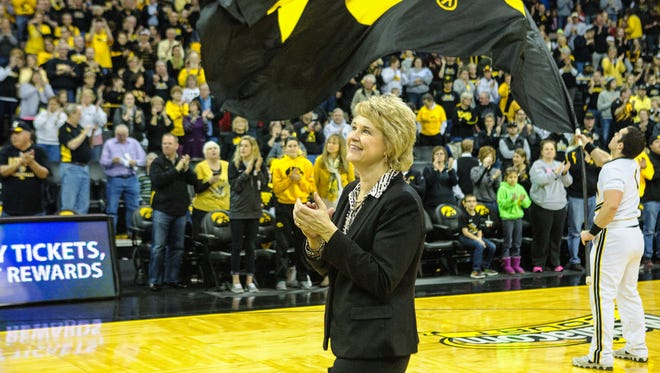 Iowa head coach Lisa Bluder celebrates with the crowd during post-game festivities on senior day at Carver-Hawkeye Arena in Iowa City on Sunday, March 1, 2015. The Hawkeyes beat the Gophers 92-76. (Justin Torner/Freelance for the Press-Citizen)