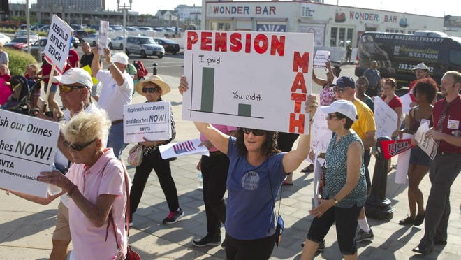 Protesters converge on a fundraiser for Gov. Chris Christie in Asbury Park on Tuesday.