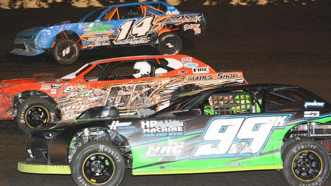 Megan Erwin (14), Jeremy Nichols (67) and Jerrad Krick race for position in the Hubert Memorial race for the street stock class. Nichols took the $2,000 special and became the first-ever repeat winner.