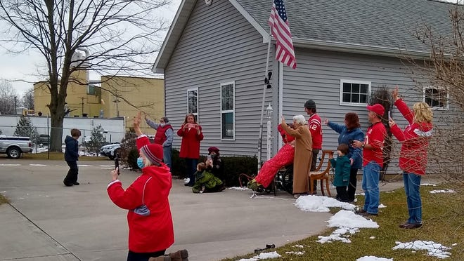 Zimont, his wife Joelen, and members of his family wave at participants in the Saturday drive-by.