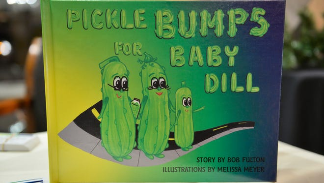 """Author Bob Fulton's book, """"Pickle Bumps for Baby Dill"""" was available during the Nov. 14 St. Cloud art crawl."""