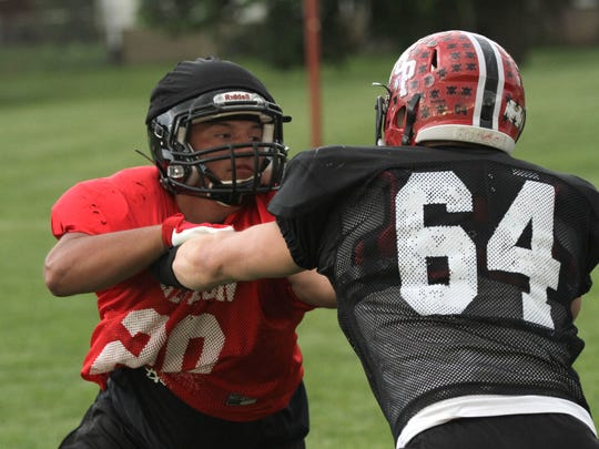 Bucyrus' Zane Richardson faces off against a PNorwalk St. Paul player during the north practice at Shelby High School practice field for the NCO All-Star Football classic on Tuesday.