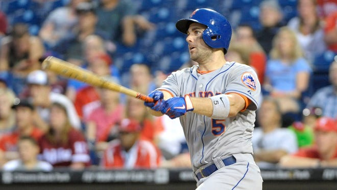 The Mets' David Wright connects on the game-winning hit in the 14th inning against the Philadelphia Phillies at Citizens Bank Park. The Mets won 5-4.