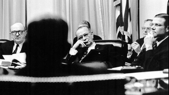 """U.S. President Lyndon B. Johnson, flanked by State Secretary Dean Rusk, left, and Defense Secretary Robert McNamara, right, listens to an exchange of views on Jan. 28, 1966, during discussion in the White House on the resumption of bombing Noth Vietnam. McNamara, who helped draw the United States deeply into the Vietnam War, now admits: """"We were terribly wrong.'' With the upcoming release of his memoirs, McNamara, 78, is breaking his quarter-century public silence on the war that left 58,000 young American men dead and bitterly divided U.S. society."""