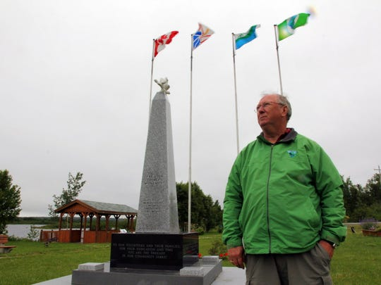 Derm Flynn, the Mayor of Appleton -a neighboring town of Gander, stands in the Peace Park where a 9/11 Memorial was built.