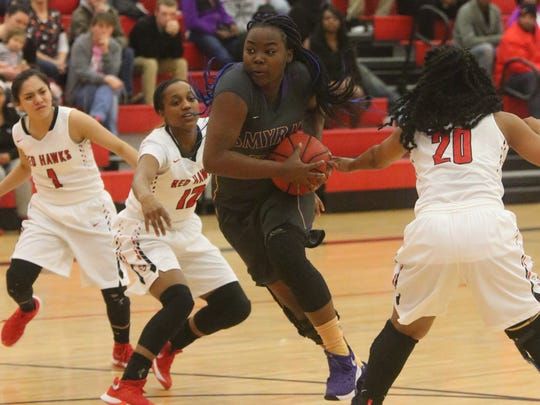 Smyrna's Tyra Hughes drives toward the bucket against Stewarts Creek in the Lady Bulldogs win over Creek.