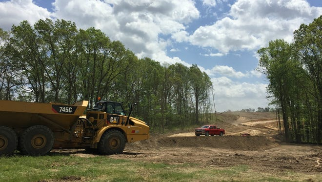 Construction equipment near the sites of future development-ready land within Battle Creek's Fort Custer Industrial Park.