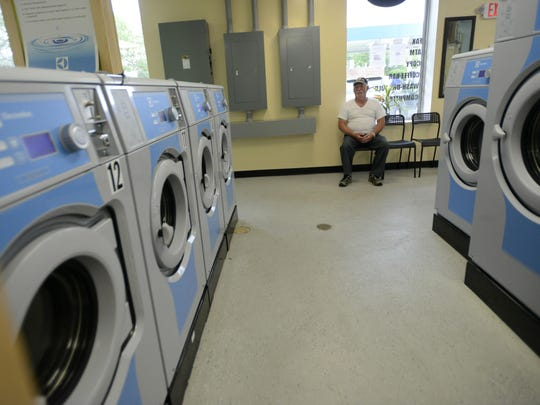 Louie Boudin of Richmond sits and waits for his laundry at Clothes Quarters Laundromat on Tuesday afternoon in Winooski. Boudin said he and his wife began doing their laundry at Clothes Quarters after receiving a recommendation from their son, another regular customer.