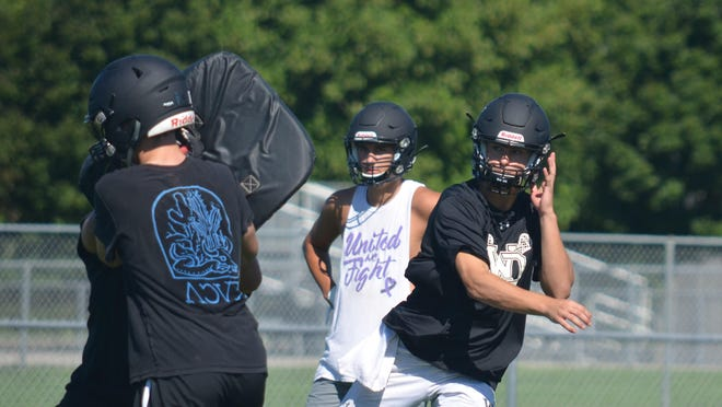 The West Ottawa football team runs a play during Tuesday's practice.