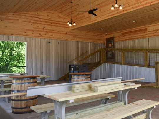 The new enclosed outdoor seating area at ConfluxCity Brewing Company in Portland, Michigan offers high pine ceilings and 1,200 square feet of space.