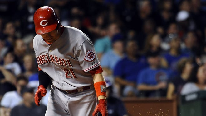 Cincinnati Reds third baseman Todd Frazier (21) slams his bat after flying out to Chicago Cubs center fielder Dexter Fowler (not pictured)  in the fourth inning at Wrigley Field.