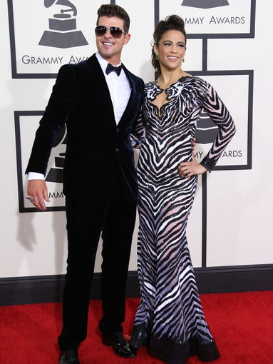 "Well, their marriage made it more than eight years. Singer Robin Thicke and actress Paula Patton announced on Feb. 24 that they're calling it quits. ""We will always love each other and be best friends, however, we have mutually decided to separate at this time,"" they told 'People.' Here, the couple pose at the Grammys on Jan. 26, 2014 in Los Angeles, in what would become one of their last public appearances as a married couple. We take a look back at their time in the spotlight together."