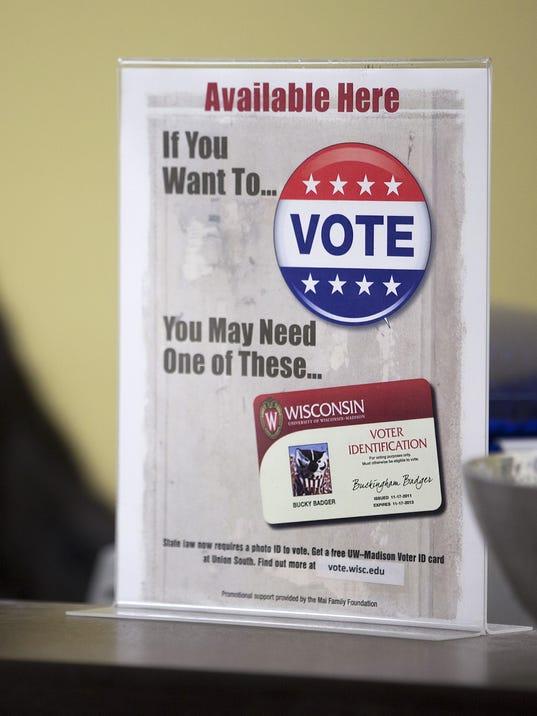 636084215675239528-voter-id-sign.jpg