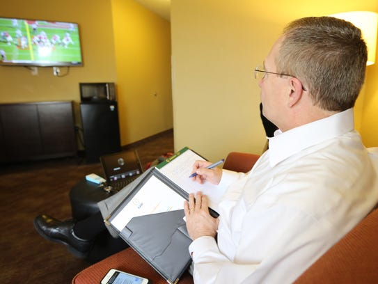 Jeff Long keeps track of lots of games on Saturdays.