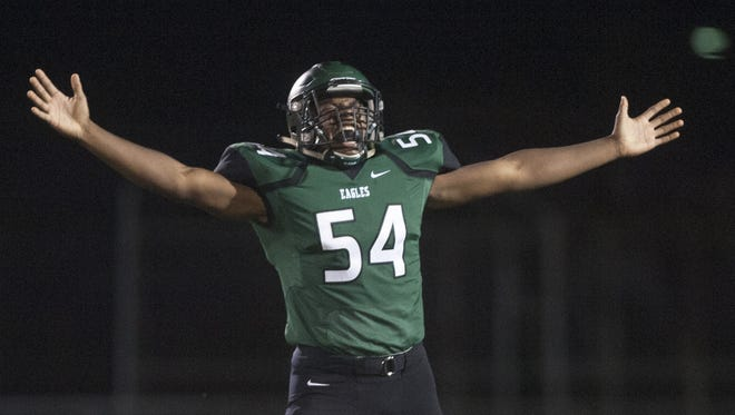 West Deptford's Nosaj Leonard reacts as his team prepares to kick the ball to Haddonfield after a West Deptford touchdown during the first quarter of Friday night's game. West Deptford won in overtime, 17-14.