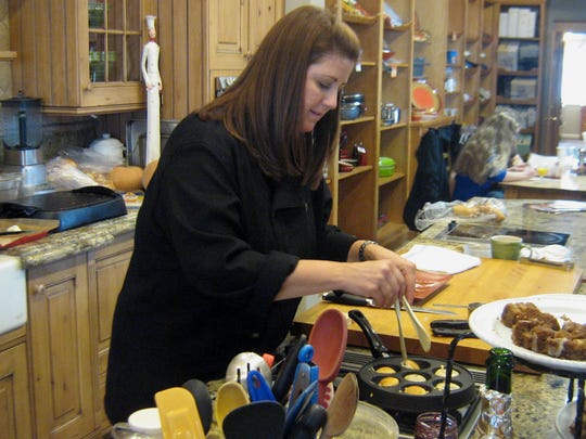 Culinary director Lara Ritchie prepares ebelskivers -- traditional spherical Danish pancakes -- at Nothing to It Culinary Center in 2011.