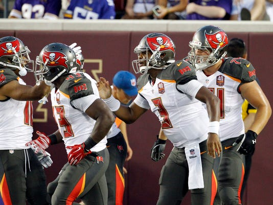 Tampa Bay Buccaneers quarterback Jameis Winston, second from right, celebrates his 8-yard touchdown run against the Minnesota Vikings during the first half of a preseason NFL football game Saturday, Aug. 15, 2015, in Minneapolis. (AP Photo/Ann Heisenfelt)