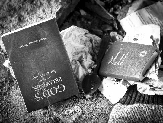 Religious reading material and other belongings lies