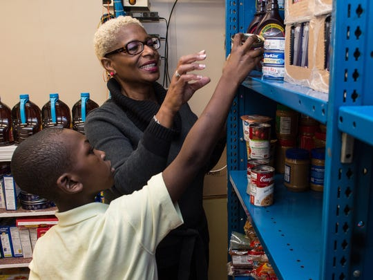 Patricia Fontaine helps fourth-grader Ta'Shy Parker