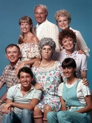 "Actress Vicki Lawrence sits in the middle of fellow cast members from the 1980s CBS show ""Mama's Family."""