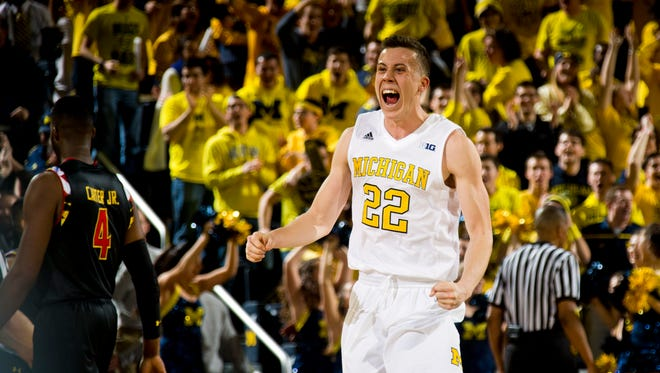 Michigan guard Duncan Robinson celebrates a win over Maryland at the Crisler Center in Ann Arbor on Tuesday, Jan. 12, 2016.
