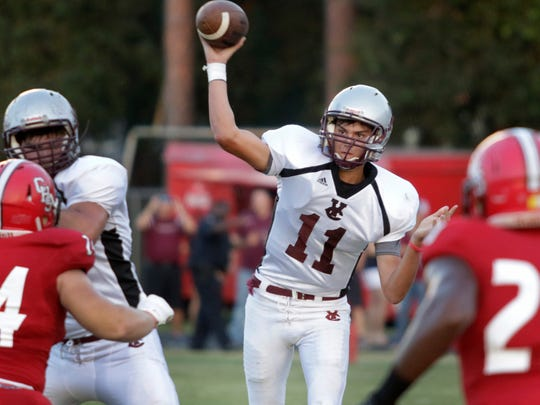 Vermilion Catholic quarterback J.T. Lege throws a passing