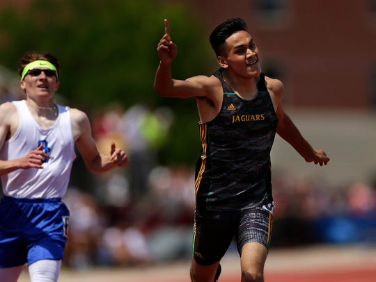 At right, Ashwaubenon's Jose Guzman celebrates as he crosses the finish line to win the WIAA Division 1 400-meter dash during the WIAA state track and field meet as a sophomore. Guzman defended his title last year and is attempting to become the first to win three straight.