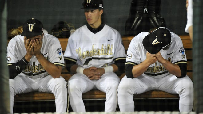 Vanderbilt's Jordan Sheffield, left, Jeren Kendall and Carson Fulmer sit dejectedly in the dugout after a 4-2 loss to Virginia in the final game of the College World Series on Wednesday at TD Ameritrade Park in Omaha, Neb.