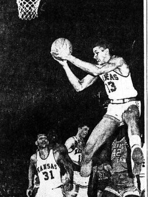 JAYHAWKER AIRBORNE - Walt Wesley (13), Kansas University, jumps high to take the ball off the boards in first period of game with Texas Western college at the NCAA Regional Playoff in Lubbock Saturday night. David Lattin (42) is behind Wesley. Others are KU's Al Lopes (31) and TWC's Orsten Artis (23). Texas Western won, 81-80.