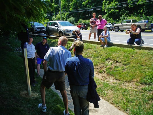 Supporters watch on from Limestone Road during a ceremony unveiling a historic marker marking the spot where the British army camped in Hockessin in the days before the Battle of Brandywine.