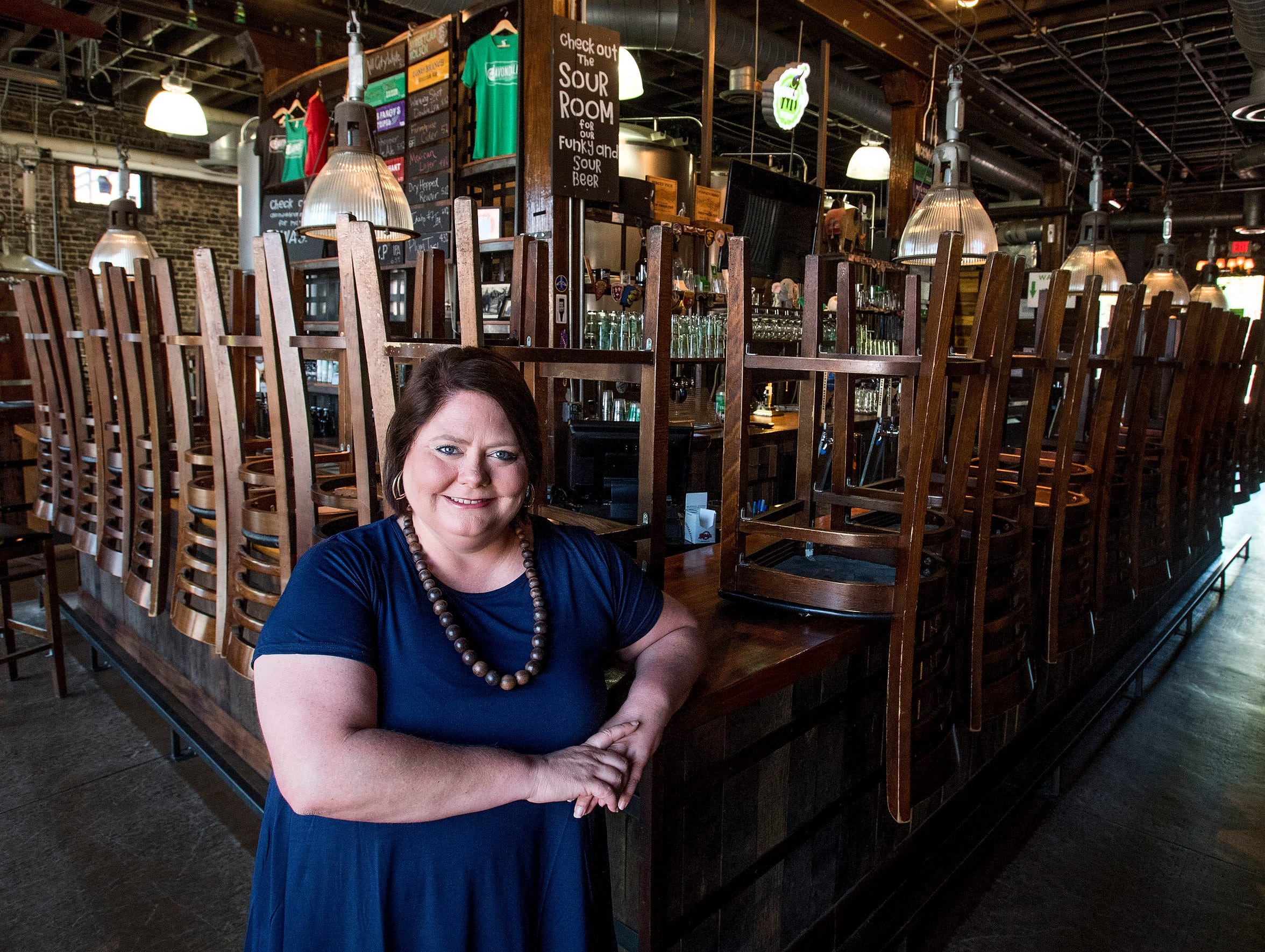"""Taylor Lander at Avondale Brewing. Lander doesn't remember much at all about Avondale before the changes. """"It wasn't very memorable,"""" she laughed. """"You had to go this way to go to the airport. You drove through, and it was abandoned buildings."""""""