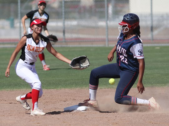 Karli Mannie tries to make a play against St. Paul, May 22, 2018.