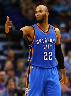 Taj Gibson (22) reacts against the Phoenix Suns at Talking Stick Resort Arena.