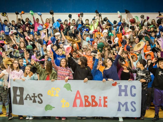 Harper Creek Middle School students show hats off for Abigail Kopf as part of a fundraiser on Friday at Harper Creek Middle School.