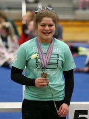 Plymouth gymnast Emily Caragay displays her regional