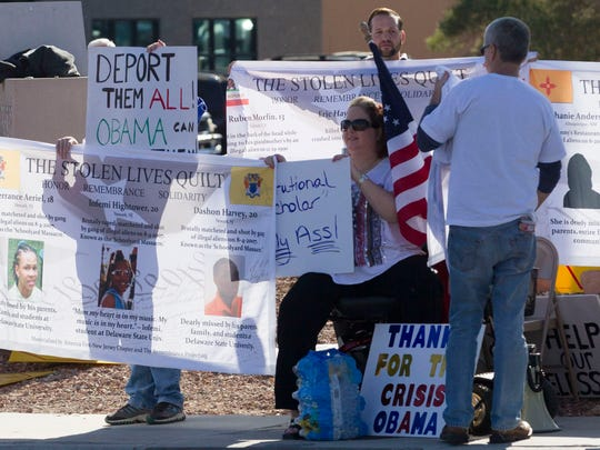 Protestors waits outside Del Sol High School in Las Vegas for President Obama's motorcade on Friday, Nov. 21, 2014.