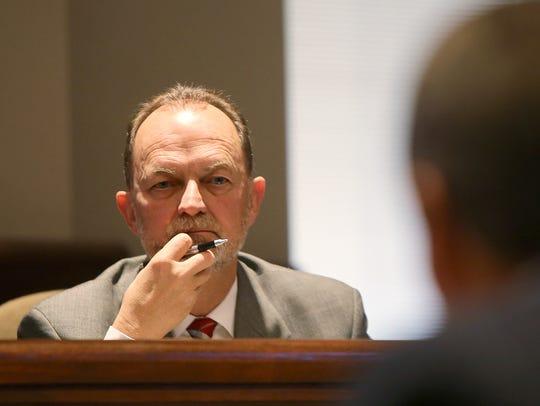 City Councilman Randy Wallace, left, listens as a representative