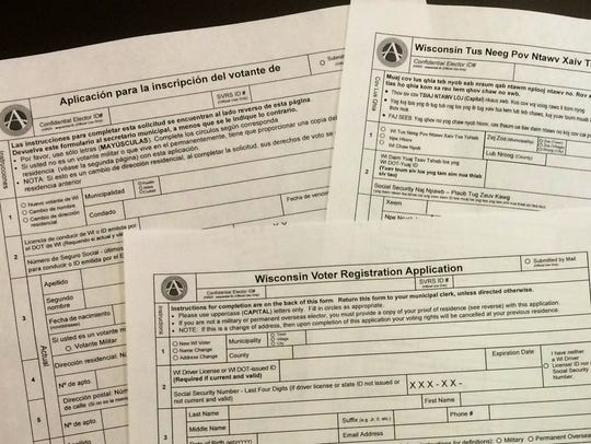Voter registration forms in English, Spanish and Hmong