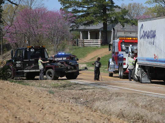 """Crews work to clear an accident near the Gibson County/Dyer County line on Monday, March 28, 2016. A tractor-trailer overturned. Edith Moore said she was inside her home around 10:15 a.m. when she """"heard the awfullest boom,"""" and that she went to the window and saw """"the truck was on its side."""""""