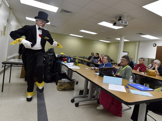 """Demonstrating a type of slow-motion dance for parades, Fred Wittig of Sturgeon Bay conducted a class on """"clowning'' at Northeast Wisconsin Technical College in Sturgeon Bay on Monday, March 27, 2017. To see a video of the Wittig creating his signature flower balloons, click onto: www.doorcountyadocate.com."""