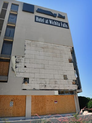 A vacant hotel on Central Freeway, across from the waterfall is seen Tuesday in Wichita Falls. The hotel's owner claims to be  in the process of remodeling the building and aims to reopen in a year or two.
