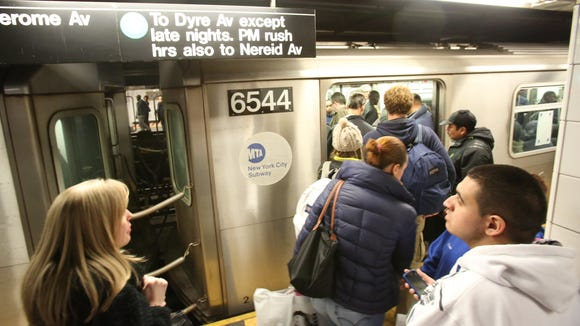 Commuters board subways north from Grand Central Station March 12, 2014.