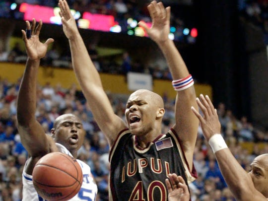 FILE -  IUPUI's Odell Bradley is stripped of the ball as he goes to the basket against Kentucky's (L to R) Marquis Estill and Keith Bogans in the second period of NCAA First Round action in Nashville, Tenn., March 21, 2003.