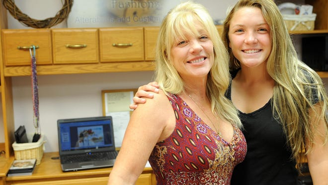 Cindy Speck and her daughter Bree stand in the workroom of HomeSpun Fashions. HomeSpun is a new business that features alterations and custom sewing. Speck mentioned beginning classes for children in October.
