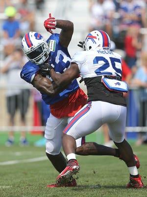 Bills linebacker Nigel Bradham tries to beat the pass blocking of running back LeSean McCoy.