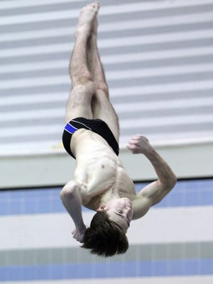 Maine-Endwell's Jordan Klym executes a dive Friday during the state swimming and diving championships at the Nassau Aquatic Center.