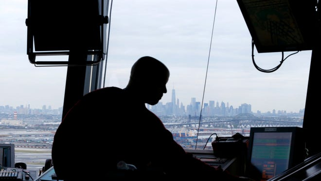 An air traffic controller works in the tower at Newark Liberty International Airport on May 21, 2015.